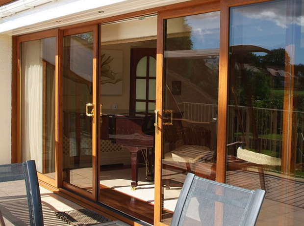 Upvc patio doors securahome for Center sliding patio doors